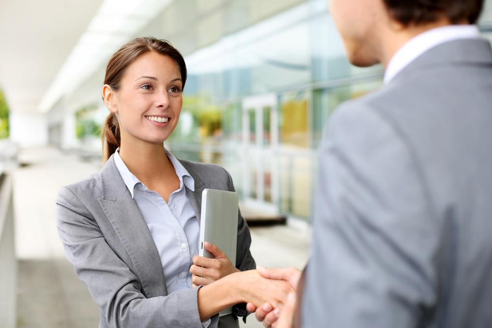 Businesswoman shaking hand to partner.jpeg