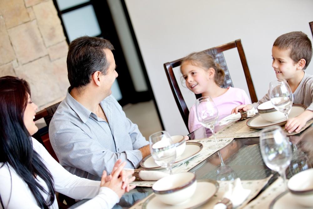 Happy family having dinner in the dinning room.jpeg