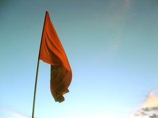 red-flag-in-sunset-1400805-640x480.jpg